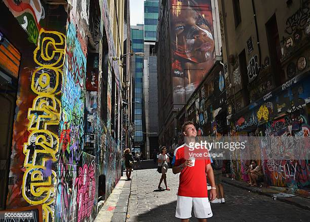Omar Jasika of Australia poses holding a coffee in Hosier Lane during day two of the 2016 Australian Open at Melbourne Park on January 19 2016 in...