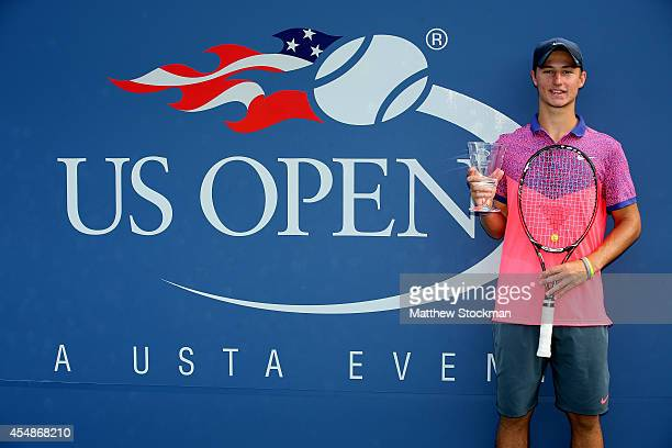Omar Jasika of Australia poses with the champions trophy after defeating Quentin Halys of France during their junior boys' singles final match on Day...