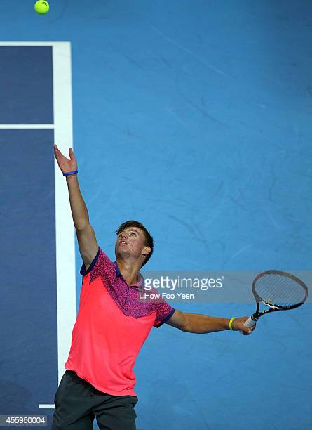 Omar Jasika of Australia serves against Rajeev Ram of USA during the Malaysian Open at Putra Stadium on September 23 2014 in Kuala Lumpur Malaysia