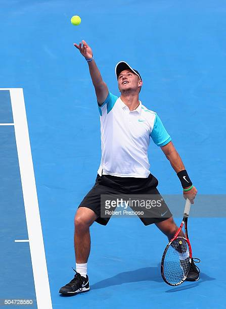 Omar Jasika of Australia serves in his match against Kei Nishikori of Japan during day two of the 2016 Kooyong Classic at Kooyong on January 13 2016...