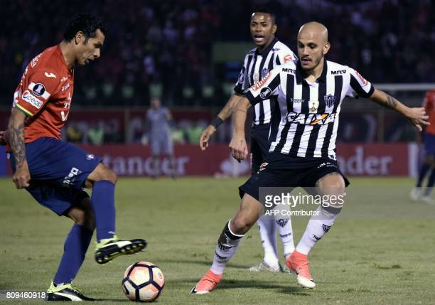 Omar Jesús Morales of Bolivia's Wilstermann vies for the ball with Fábio Santos of Brazil's Atletico Mineiro during their Copa Libertadores football...