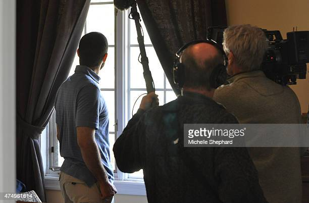 Omar Khadr is filmed for a documentary on his life as he looks out the window of his bedroom on May 9 2015 Two days earlier the 28 year old was...