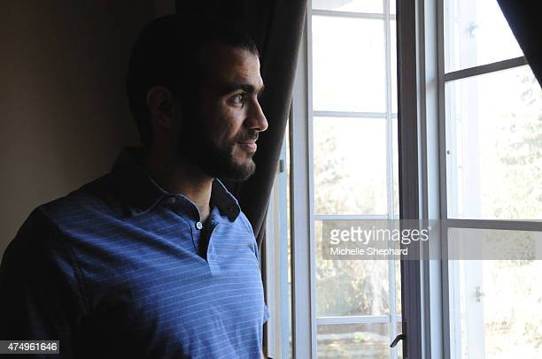 Omar Khadr looks out the window of his home on May 9 two days after being freed after having spent nearly half of his life in custody
