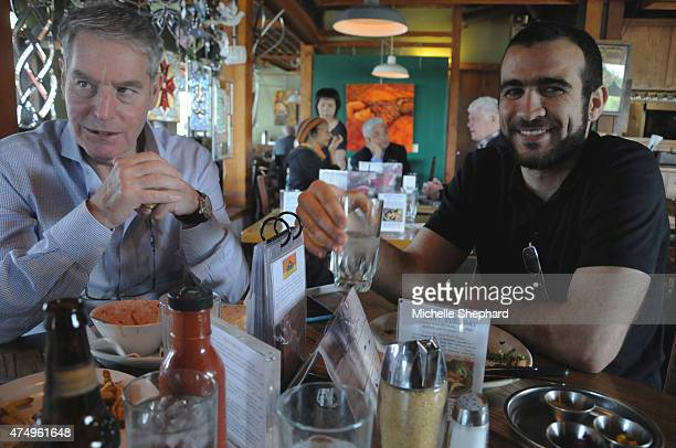 Omar Khadr on his first day of freedom after nearly 13 years in prison shares lunch with his longtime Canadian lawyer Dennis Edney