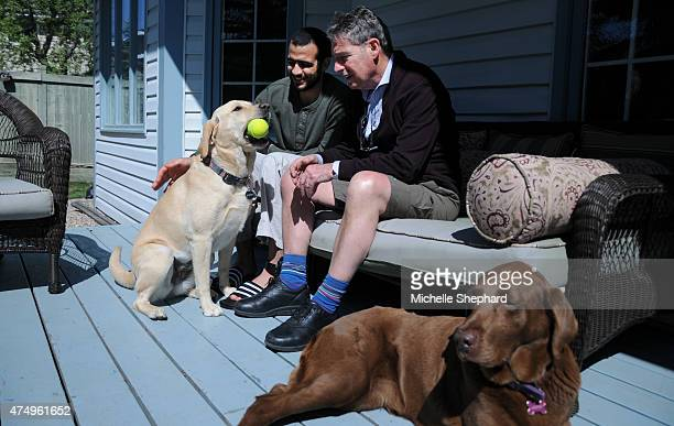 Omar Khadr on May 9 with his longtime Canadian lawyer Dennis Edney and Edney's dogs Molly and Jasper Edney along with his wife Patricia have offered...