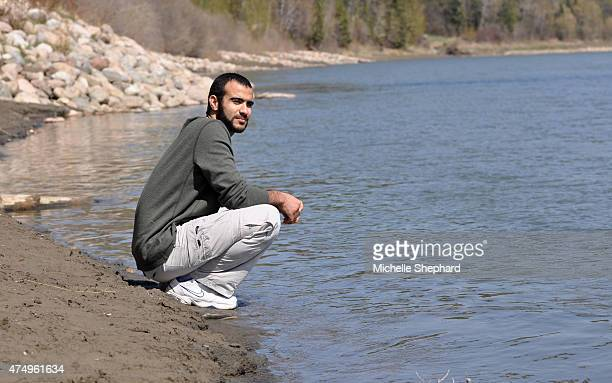Omar Khadr stops to look out on the North Saskatchewan river during his first long walk and bike ride on May 9 two days after being freed after...