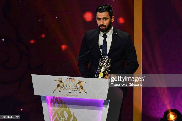 BANGKOK THAILAND NOVEMBER Omar Khrbin from Syria speaks with his AFC Player of the Year award 2017 during the 2017 AFC Annual Awards on November 29...