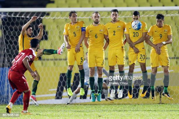 Omar Khrbin of Syria takes a free kick during the 2018 FIFA World Cup Asian Playoff match between Syria and the Australia Socceroos at Hang Jebat...