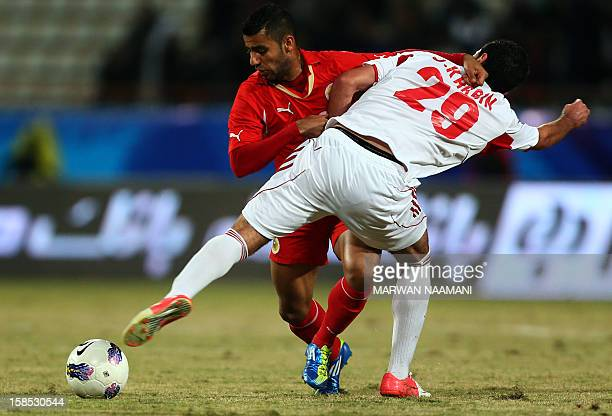 Omar Khrbin of Syria vies for the ball against Abdulwahab alSafi of Bahrain during their semifinal football match in the 7th West Asia Football...