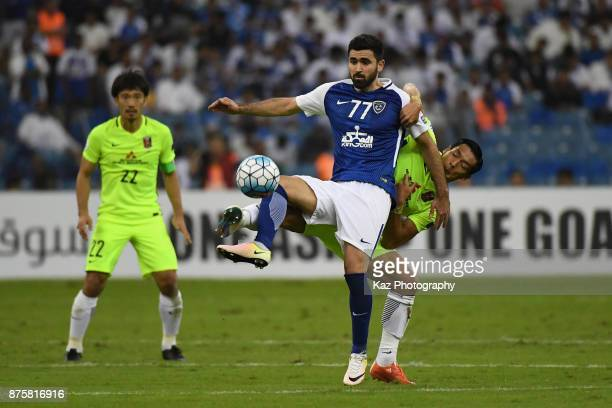 Omar Khribin of AlHilal controls the ball under pressure of Tomoaki Makino of Urawa Red Diamonds during the AFC Champions League Final 2017 first leg...