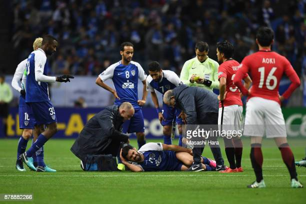 Omar Khribin of AlHilal receives medical treatment after fouled by Tomoya Ugajin of Urawa Red Diamonds during the AFC Champions League Final second...