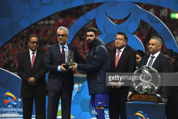 Omar Khribin of AlHilal receives the Golden Boots Trophy at the medal ceremony after the AFC Champions League Final second leg match between Urawa...