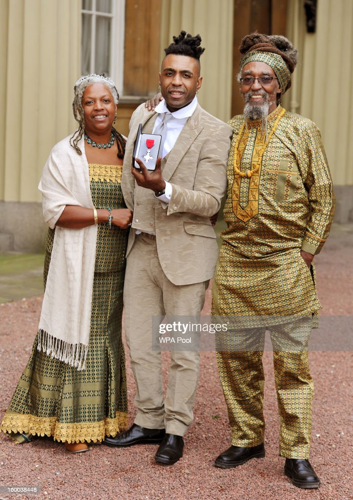 Omar Lyefook with his parents Sonia and Byron proudly holds his Member of the British Empire (MBE) medal after it was presented to him by the Prince of Wales during the Investiture ceremony at Buckingham Palace on January 25, 2013 in London, England.