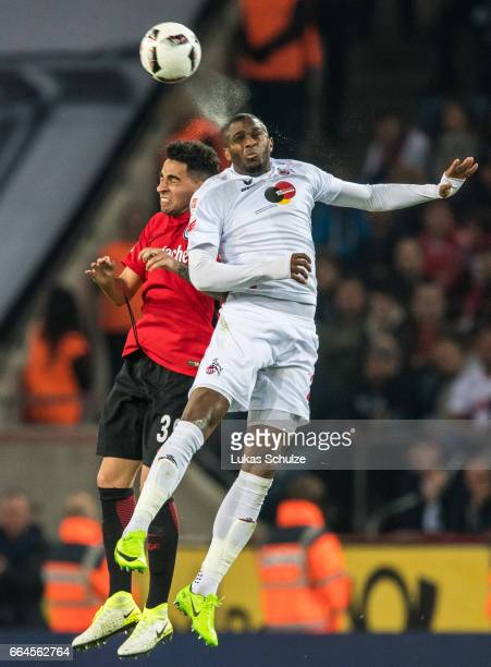 Omar Mascarell of Frankfurt and Anthony Modeste of Koeln in action during the Bundesliga match between 1 FC Koeln and Eintracht Frankfurt at...