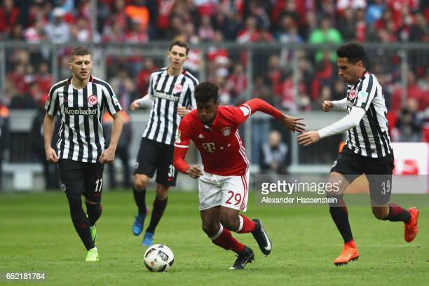 Omar Mascarell of Frankfurt battles for the ball with Kingsley Coman of Muenchen during the Bundesliga match between Bayern Muenchen and Eintracht...