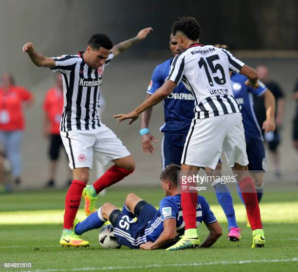 Omar Mascarell of Frankfurt KlaasJan Huntelaar of Schalke and Michael Hector of Frankfurt battle for the ball during the Bundesliga match between...