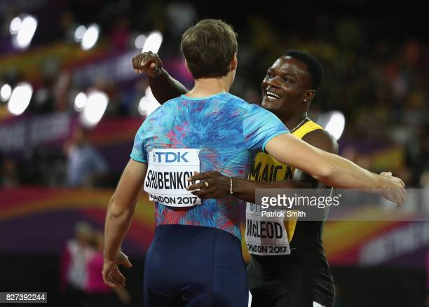 Omar McLeod of Jamaica celebrates with Sergey Shubenkov after winning the Men's 110 metres hurdles final during day four of the 16th IAAF World...