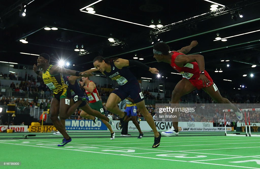 Omar Mcleod of Jamaica (L) crosses the line to win gold ahead of silver medallist <a gi-track='captionPersonalityLinkClicked' href=/galleries/search?phrase=Pascal+Martinot-Lagarde&family=editorial&specificpeople=7114926 ng-click='$event.stopPropagation()'>Pascal Martinot-Lagarde</a> of France (R) in the Men's 60 Metres Hurdles Final during day four of the IAAF World Indoor Championships at Oregon Convention Center on March 20, 2016 in Portland, Oregon.