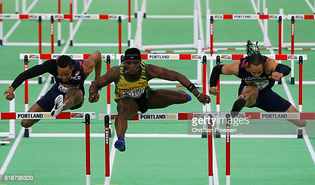 Omar Mcleod of Jamaica on his way to winning gold ahead of silver medallist Pascal MartinotLagarde of France and bronze medallist Dimitri Bascou of...