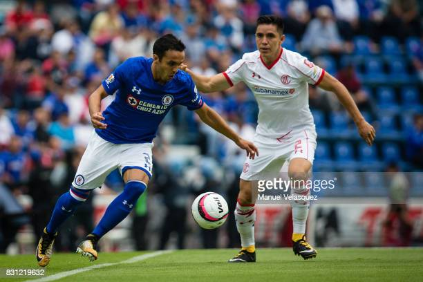 Omar Mendoza of Cruz Azul struggle for the ball against Efrain Velarde of Toluca during the 4th round match between Cruz Azul and Chivas as part of...