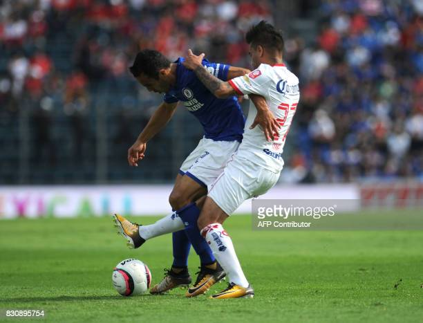 Omar Mendoza of Cruz Azul vies for the ball with Rodrigo Gomez of Toluca during their Mexican Torneo Apertura 2017 football match at Azul Stadium in...