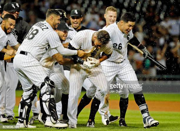 Omar Narvaez of the Chicago White Sox and Avisail Garcia celebrate with Yoan Moncada after he hit a walkoff RBI single against the Houston Astros...