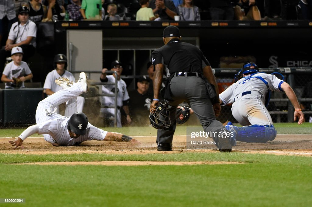 Omar Narvaez (L) of the Chicago White Sox is safe at home as he beats the tag from Drew Butera #9 of the Kansas City Royals during the seventh inning on August 12, 2017 at Guaranteed Rate Field in Chicago, Illinois. The Royals defeated the White Sox 5-4.