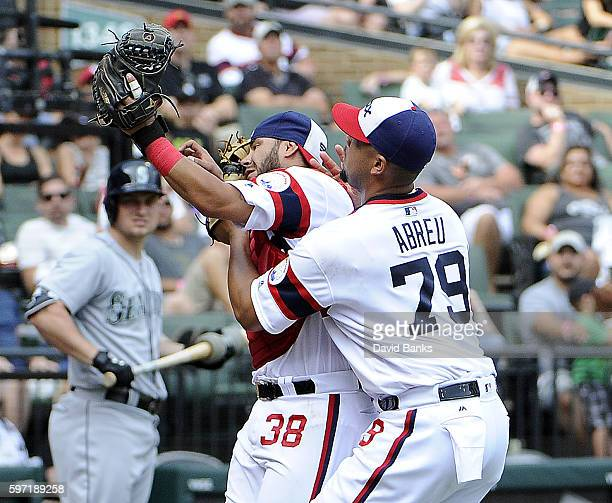 Omar Narvaez of the Chicago White Sox makes a catch against the Seattle Mariners as Jose Abreu collides with him during the ninth inning on August 28...