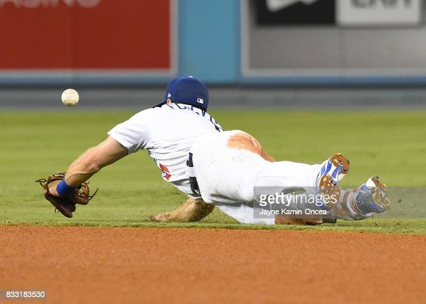 Omar Narvaez of the Chicago White Sox singles past Logan Forsythe of the Los Angeles Dodgers in the fifth inning of the game at Dodger Stadium on...