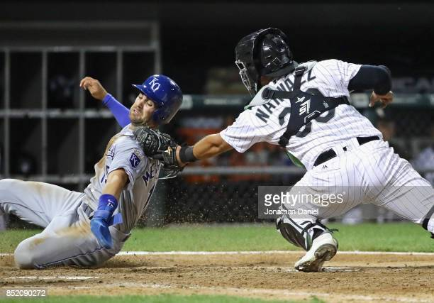 Omar Narvaez of the Chicago White Sox tags out Whit Merrifield of the Kansas City Royals in the 9th inning to start a double play to end the game at...