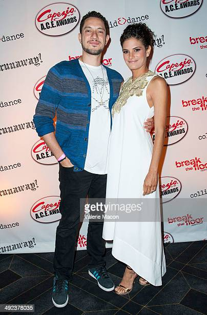 Omar Offendum and Ashley Dyke arrive at CollidEdance's 'Runaway' An AllMale Dance Theatre Production Opening Nightat Avalon on May 19 2014 in...