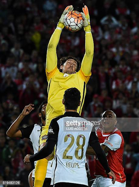 Omar Perez of Colombia's Santa Fe vies for the ball with Brazilian Corinthians goalkeeper Cassio during their Libertadores Cup football match at El...