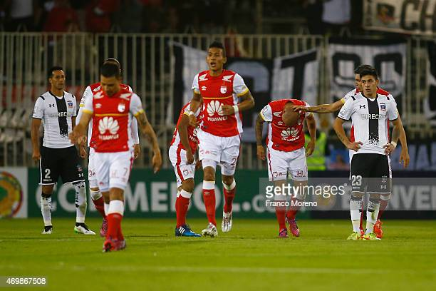 Omar Perez of Independiente Santa Fe celebrates after scoring his team's second goal during a match between ColoColo and Independiente de Santa fe as...