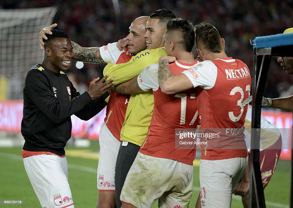 Omar Perez of Santa Fe celebrates with teammates after winning a second leg final match between Santa Fe and Deportes Tolima as part of Liga Aguila II 2016 at El Campin Stadium on December 18, 2016 in Bogota, Colombia.