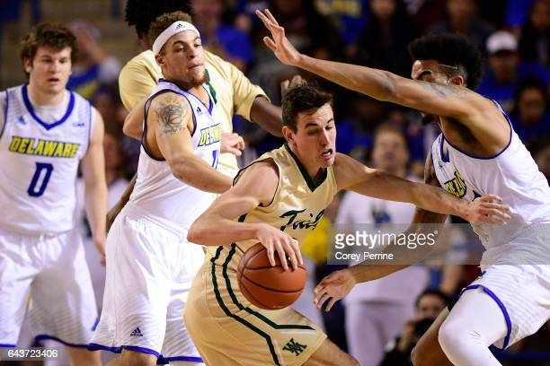 Omar Prewitt of the William Mary Tribe dribbles against Eric Carter of the Delaware Fightin Blue Hens during the first half at the Bob Carpenter...
