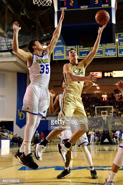 Omar Prewitt of the William Mary Tribe scores on Jacob Cushing of the Delaware Fightin Blue Hens during the second half at the Bob Carpenter Center...