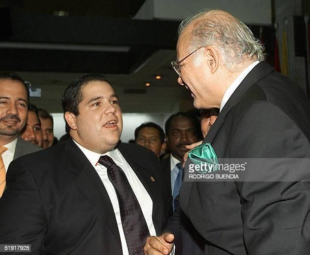 Omar Quintana diputado del Partido Roldosista Ecuatoriano saluda a Jacobo Bucaram hijo del ex presidente Abdala Bucaram despues de haber sido electo...