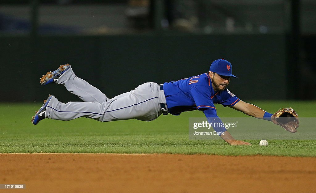 <a gi-track='captionPersonalityLinkClicked' href=/galleries/search?phrase=Omar+Quintanilla&family=editorial&specificpeople=551479 ng-click='$event.stopPropagation()'>Omar Quintanilla</a> #3 of the New York Mets dives for the ball in the 9th inning against the Chicago White Sox at U.S. Cellular Field on June 25, 2013 in Chicago, Illinois. The White Sox defeated the Mets 5-4.