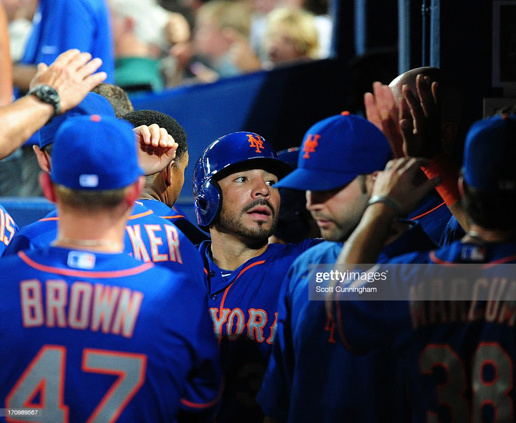 <a gi-track='captionPersonalityLinkClicked' href=/galleries/search?phrase=Omar+Quintanilla&family=editorial&specificpeople=551479 ng-click='$event.stopPropagation()'>Omar Quintanilla</a> #3 of the New York Mets is congratulated by teammates after scoring against the Atlanta Braves at Turner Field on June 20, 2013 in Atlanta, Georgia.