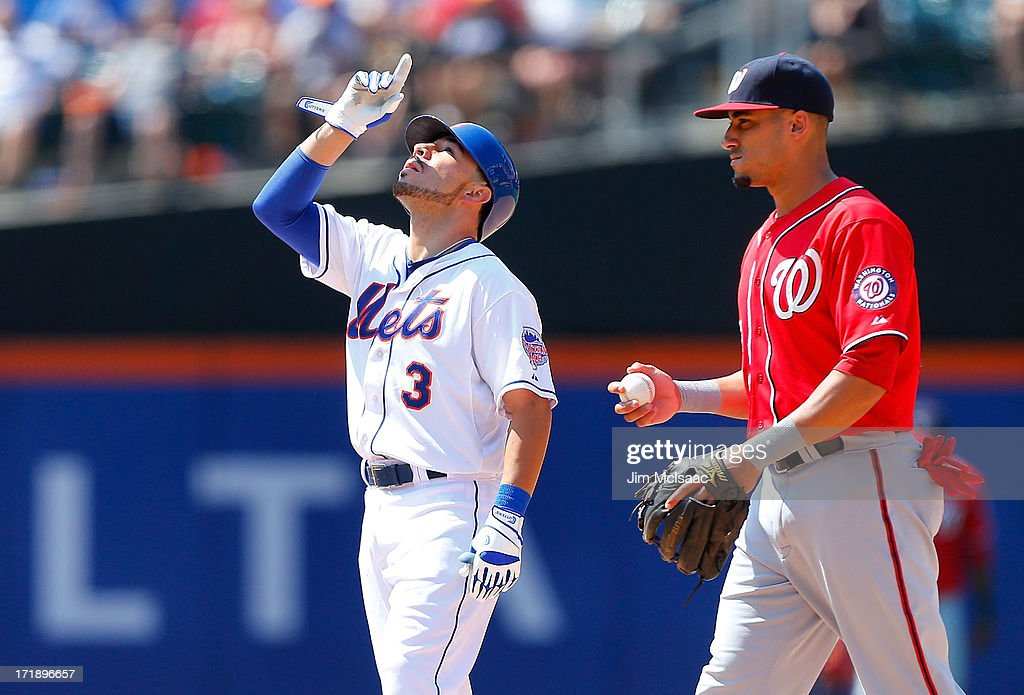 <a gi-track='captionPersonalityLinkClicked' href=/galleries/search?phrase=Omar+Quintanilla&family=editorial&specificpeople=551479 ng-click='$event.stopPropagation()'>Omar Quintanilla</a> #3 of the New York Mets reacts after his sixth inning double as <a gi-track='captionPersonalityLinkClicked' href=/galleries/search?phrase=Ian+Desmond&family=editorial&specificpeople=835572 ng-click='$event.stopPropagation()'>Ian Desmond</a> #20 of the Washington Nationals looks on at Citi Field on June 29, 2013 in the Flushing neighborhood of the Queens borough of New York City. The Mets defeated the Nationals 5-1.
