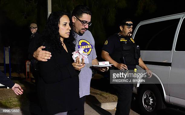 Omar Riopedre embraces his wife Diana who was in the Inland Regional Center when the mass shootings took place as they leave the Rudy C Hernandez...