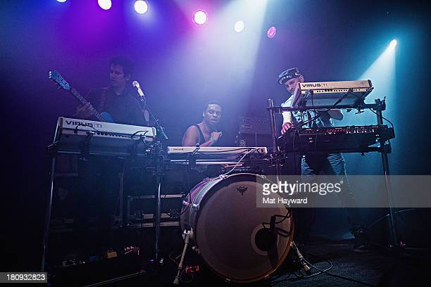 Omar Rodriguez Lopez Deantoni Parks and Nicci Kasper of the Bosnian Rainbows perform on stage at the Crocodile on September 17 2013 in Seattle...