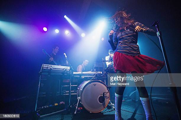 Omar Rodriguez Lopez Deantoni Parks and Teri Gender Bender of the Bosnian Rainbows perform on stage at the Crocodile on September 17 2013 in Seattle...