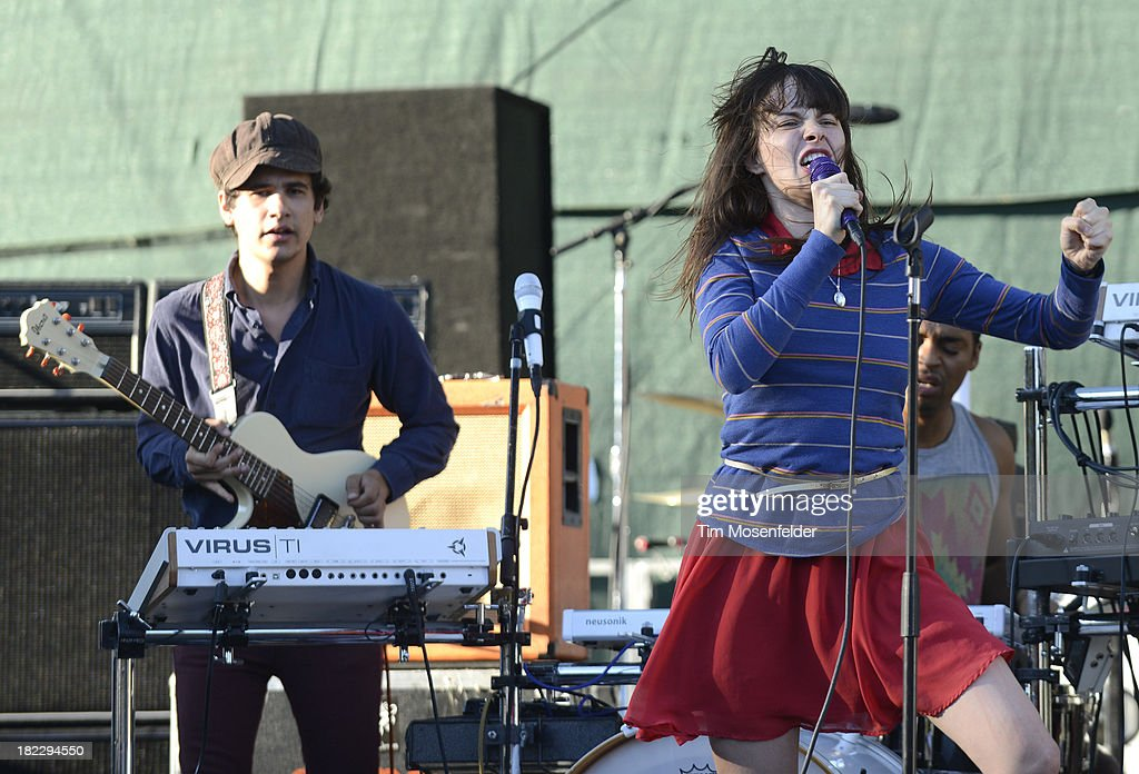 Omar Rodriguez-Lopez (L) and Teri Gender Bender of Bosnian Rainbows perform as part of C2SV Music Festival Day Three at St. James Park on on September 28, 2013 in San Jose, California.