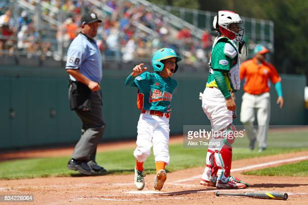 Omar Romero of Team Latin America from Venezuela reacts on his way to scoring during Game 1 of the 2017 Little League World Series against Team...