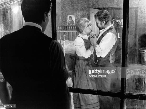 Omar Sharif learns by watching through the window that Julie Christie and Rod Steiger are having a relationship in a scene from the film 'Doctor...