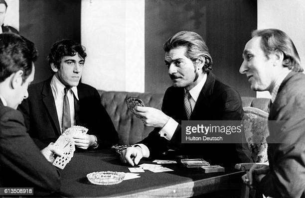 Omar Sharif plays a tense game of bridge with some of the games best players as part of a televised competition