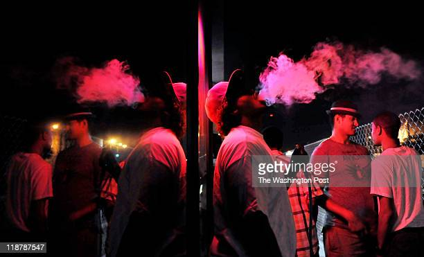 Omar Sharif smokes a hookah pipe outside the 280 Hookah bar on June 24 in St Paul MN This hookah joint is a regular hangout spot for young Somali men...