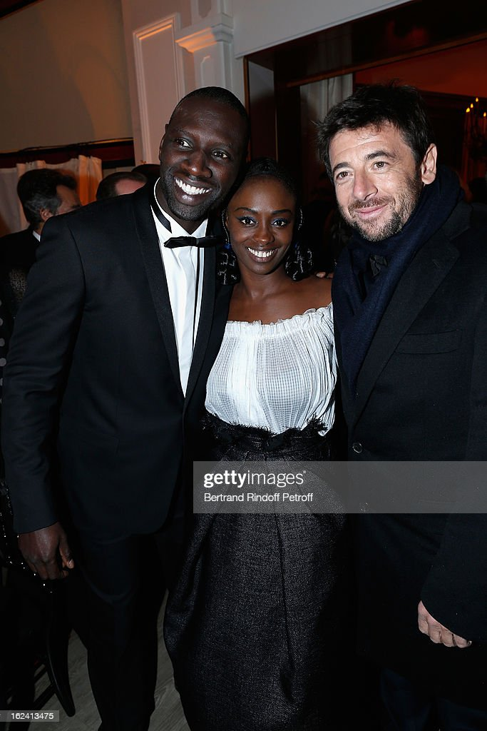 <a gi-track='captionPersonalityLinkClicked' href=/galleries/search?phrase=Omar+Sy&family=editorial&specificpeople=4110364 ng-click='$event.stopPropagation()'>Omar Sy</a>, Aissa Maiga and <a gi-track='captionPersonalityLinkClicked' href=/galleries/search?phrase=Patrick+Bruel&family=editorial&specificpeople=549816 ng-click='$event.stopPropagation()'>Patrick Bruel</a> attend the Cesar Film Awards 2013 at Le Fouquet's on February 22, 2013 in Paris, France.