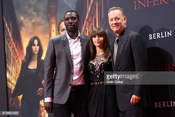 Omar Sy Felicity Jones and Tom Hanks attend the German premiere of the film 'INFERNO' at Sony Centre on October 10 2016 in Berlin Germany